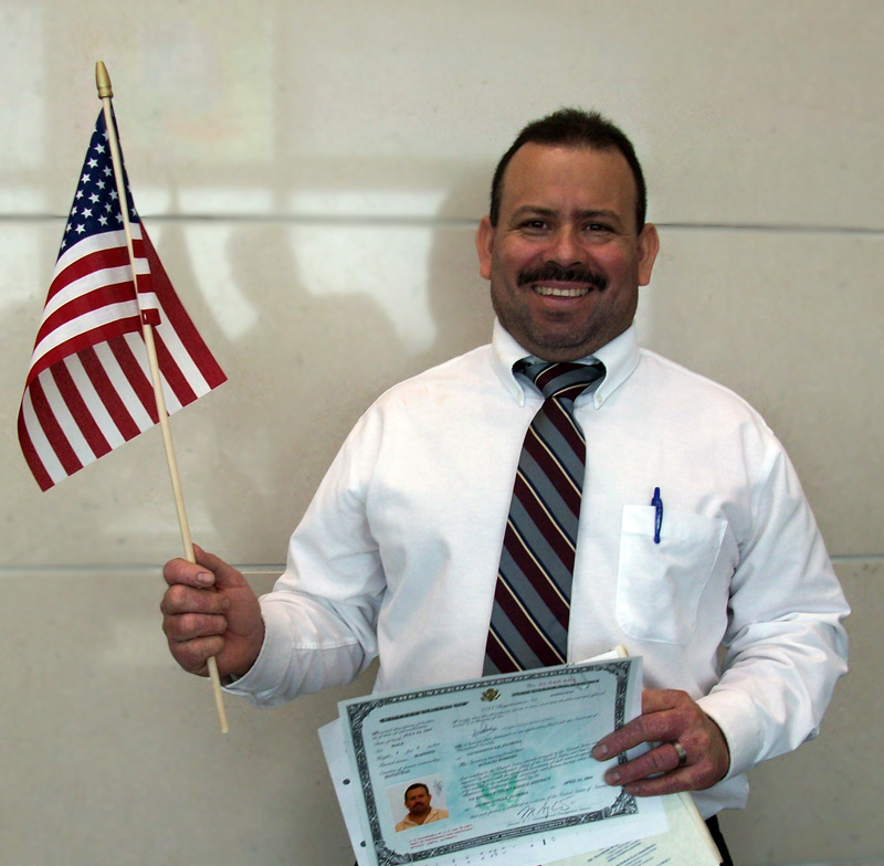Ignacio with Flag at Citizenship cerimony