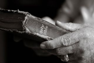 Bible and hands 1